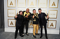 Michael Govier, Travon Free, Martin Desmond Roe and Will McCormack pose backstage with the Oscar® for Animated Short Film during the live ABC Telecast of The 93rd Oscars® at Union Station in Los Angeles, CA on Sunday, April 25, 2021.<br /> *Editorial Use Only*<br /> ©A.M.P.A.S.<br /> Image supplied by Capital Pictures
