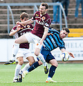 Forfar's Dale Hilson is bundled off the ball by Stenny's Kieran Millar and Paul John Sluden (16).