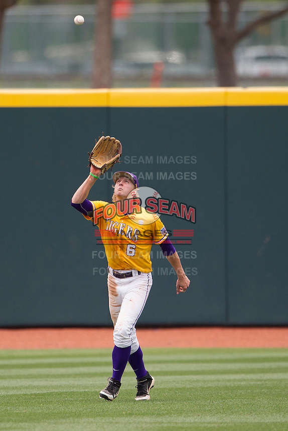 LSU Tigers outfielder Andrew Stevenson (6) camps under a fly ball against the Texas A&M Aggies in the NCAA Southeastern Conference baseball game on May 11, 2013 at Blue Bell Park in College Station, Texas. LSU defeated Texas A&M 2-1 in extra innings to capture the SEC West Championship. (Andrew Woolley/Four Seam Images).