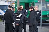 """Ca. 50 Neonazis der NPD, der Neonazi-Partei """"Die Rechte"""" und Hooligans protestierten am 20. April 2015 in Berlin Marzahn-Hellersdorf gegen eine geplante Fluechtlingsunterkunft. Die Neonazis wollten ein """"Geburtstagsstaendchen"""" anlaesslich des Hitlergeburtstages (20. April) singen, dies wurde ihnen von der Polizei jedoch untersagt.<br /> Im Bild: Polizeibeamte haben von anreisenden Rechten schwarz-weiß-rote Fahnen beschlagnahmt, nun beschweren sich die Rechten. Rechts mit Sonnenbrille: Daniela Froehlich, Rechtsradikale Aktivistin gegen die Fluechtlingsunterkunft.<br /> 20.4.2015, Berlin<br /> Copyright: Christian-Ditsch.de<br /> [Inhaltsveraendernde Manipulation des Fotos nur nach ausdruecklicher Genehmigung des Fotografen. Vereinbarungen ueber Abtretung von Persoenlichkeitsrechten/Model Release der abgebildeten Person/Personen liegen nicht vor. NO MODEL RELEASE! Nur fuer Redaktionelle Zwecke. Don't publish without copyright Christian-Ditsch.de, Veroeffentlichung nur mit Fotografennennung, sowie gegen Honorar, MwSt. und Beleg. Konto: I N G - D i B a, IBAN DE58500105175400192269, BIC INGDDEFFXXX, Kontakt: post@christian-ditsch.de<br /> Bei der Bearbeitung der Dateiinformationen darf die Urheberkennzeichnung in den EXIF- und  IPTC-Daten nicht entfernt werden, diese sind in digitalen Medien nach §95c UrhG rechtlich geschuetzt. Der Urhebervermerk wird gemaess §13 UrhG verlangt.]"""