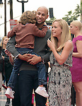 Kendra Wilkinson and Hank Baskett with their son attend The TWC- Dimension L.A. Premiere of Paddington held at The TCL Chinese Theater  in Hollywood, California on January 10,2015                                                                               © 2015 Hollywood Press Agency