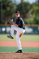Steven Azzaro (64) of Olathe, Kansas during the Baseball Factory Pirate City Christmas Camp & Tournament on December 29, 2018 at Pirate City in Bradenton, Florida. (Mike Janes/Four Seam Images)