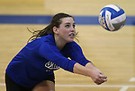 Marymount's Erin Allison gets a dig during a college volleyball match at Washington & Lee University Lexington, Vir., on Saturday, Oct. 5, 2013.<br /> Photo by Cathleen Allison