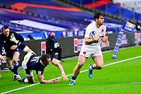 26th March 2021, Stade de France, Saint-Denis, France; Guinness 6-Nations international rugby, France versus Scotland;  Damian Penaud (Fra) breaks the tackle of Duhan Van Der Merwe (Sco)