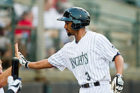 Marcus Semien (3) of the Charlotte Knights high fives a teammate after hitting a home run against the Lehigh Valley IronPigs at Knights Stadium on August 6, 2013 in Fort Mill, South Carolina.  The IronPigs defeated the Knights 4-1.  (Brian Westerholt/Four Seam Images)