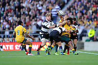 Henry Speight of Australia offloads to Will Genia of Australia as he is tackled during the Killik Cup match between Barbarians and Australia at Twickenham Stadium on Saturday 1st November 2014 (Photo by Rob Munro)