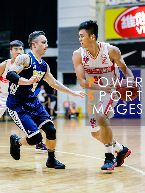Wong Tsz Him #21of Nam Ching Basketball Team handles the ball against Kepkey Tyler Alexander #55 of Winling Basketball Club during the Hong Kong Basketball League game between Nam Ching vs Winling at Southorn Stadium on May 11, 2018 in Hong Kong. Photo by Yu Chun Christopher Wong / Power Sport Images