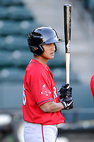 Infielder/shortstop Tzu-Wei Lin (36) of the Greenville Drive waits his turn for batting practice on the team's Media Day first workout on Tuesday, April 1, 2014, at Fluor Field at the West End in Greenville, South Carolina. Lin is the Boston Red Sox No. 28 prospect, according to Baseball America. (Tom Priddy/Four Seam Images)