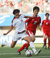 Santiago, Chile: Americar's player Sydney Leroux (L) dispute the ball with Korea DRPs player Ri Un Hyang during the finals match in the Fifa U-20 Women´s World Cup at Florida´s Municipal Stadium, on December 07 th, 2008. By Grosnia / ISIphotos.com