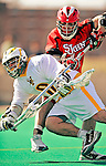 19 March 2011: University of Vermont Catamount Attacker Josh Aronson, a Sophomore from Lutherville, MD, is checked by Defender Mike Sherry, a Senior from Oceanside, NY, during game action against the St. John's University Red Storm at Moulton Winder Field in Burlington, Vermont. The Catamounts defeated the visiting Red Storm 14-9. Mandatory Credit: Ed Wolfstein Photo