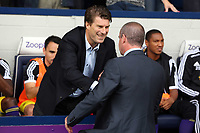 Pictured L-R: Swansea manager Michael Laudrup greets West Brom manager Steve Clarke. Sunday 01 September 2013<br /> Re: Barclay's Premier League, West Bromwich Albion v Swansea City FC at The Hawthorns, Birmingham, UK.