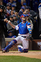 Chicago Cubs catcher David Ross (3) throws the ball back to the pitcher in the first inning during Game 5 of the Major League Baseball World Series against the Cleveland Indians on October 30, 2016 at Wrigley Field in Chicago, Illinois.  (Mike Janes/Four Seam Images)