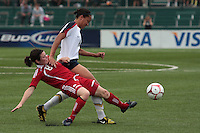 Canada's Diana Matheson (8) and USWNT's Angela Hucles (16) battle for the ball. The U.S. Women's National Team defeated 1-0 in a friendly match at Marina Auto Stadium in Rochester, NY on July 19, 2009. Abby Wambach of the USWNT scored her 100th career goal in the second half..
