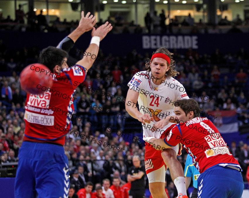 Mikkel Hansen (C) of Denmark scores during men`s EHF EURO 2012 handball championship final game between Serbia and Denmark in Belgrade, Serbia, Sunday, January 29, 2011.  (photo: Pedja Milosavljevic / thepedja@gmail.com / +381641260959)