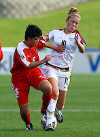 Kristie Mewis (USA) competes for the ball with Sol Hui Kim (PRK)..FIFA U17 Women's World Cup Final, USA v Korea DPR, Albany Stadium, Auckland, New Zealand, Sunday 16 November 2008. Photo: Renee McKay/PHOTOSPORT
