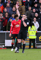 SWANSEA, WALES - FEBRUARY 21: Neil Swarbrick marks the end of the game during the Barclays Premier League match between Swansea City and Manchester United at Liberty Stadium on February 21, 2015 in Swansea, Wales.