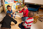 Education Preschool 4 years old group of boys playing with human figures