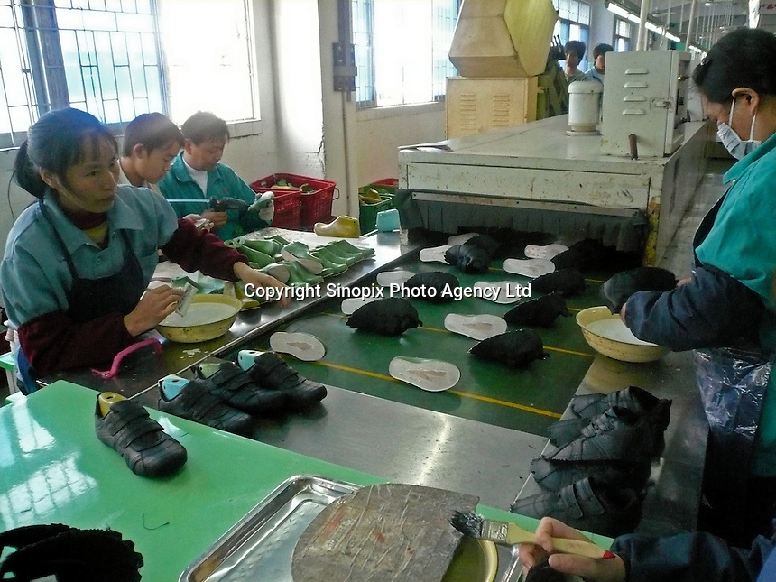 """One of the production lines of the Brilliant Footwear Company Limited in Tangxia, China, which is the factory produces trainers for the """"green"""" and """"socially conscious"""" company Wornagain..20 Mar 2007"""
