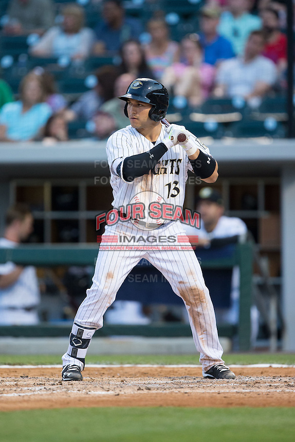 Carlos Sanchez (13) of the Charlotte Knights at bat against the Syracuse Chiefs at BB&T BallPark on June 1, 2016 in Charlotte, North Carolina.  The Knights defeated the Chiefs 5-3.  (Brian Westerholt/Four Seam Images)