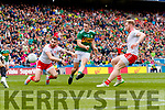 Stephen O'Brien, Kerry scores his side's only goal despite the attention of Ronan McGee, Tyrone during the All Ireland Senior Football Semi Final between Kerry and Tyrone at Croke Park, Dublin on Sunday.