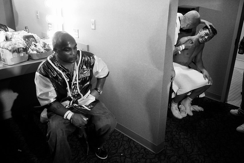 ARTURO GATTI (12/12) --Buddy (left) sits with a blank expression on his face as cutman Joe Souza works Gatti's face in the dressing room after top-ranked contender Floyd Mayweather, Jr. defeats Gatti by TKO to win the WBC junior welterweight (140 pounds) title at Atlantic City's Boardwalk Hall.  ATLANTIC CITY, NJ  6/25/05