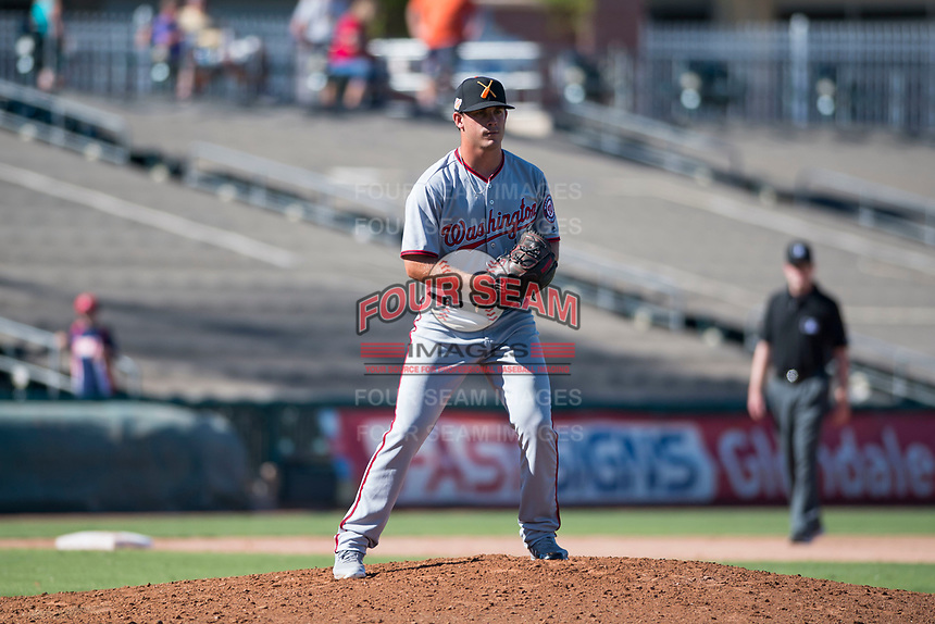Salt River Rafters relief pitcher Ben Braymer (43), of the Washington Nationals organization, gets ready to deliver a pitch during an Arizona Fall League game against the Surprise Saguaros on October 9, 2018 at Surprise Stadium in Surprise, Arizona. The Rafters defeated the Saguaros 10-8. (Zachary Lucy/Four Seam Images)