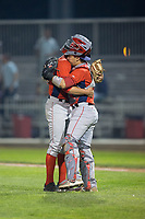 Orem Owlz relief pitcher Isaac Mattson (left) gets a hug from catcher Keinner Pina (right) after closing out the game against the Helena Brewers at Kindrick Legion Field on August 17, 2017 in Helena, Montana.  The Owlz defeated the Brewers 5-2.  (Brian Westerholt/Four Seam Images)