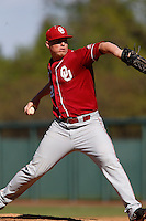 Jonathan Gray #22 of the Oklahoma Sooners pitches against the UCLA Bruins at Jackie Robinson Stadium on March 9, 2013 in Los Angeles, California. (Larry Goren/Four Seam Images)