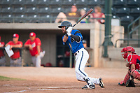 Missoula Osprey designated hitter Nick Dalesandro (8) follows through on his swing in front of catcher Griffin Barnes (28) during a Pioneer League game against the Orem Owlz at Ogren Park Allegiance Field on August 19, 2018 in Missoula, Montana. The Missoula Osprey defeated the Orem Owlz by a score of 8-0. (Zachary Lucy/Four Seam Images)