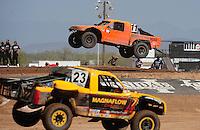 Apr 17, 2011; Surprise, AZ USA; LOORRS driver Adrian Cenni (11) and Jerry Daugherty (23) during round 4 at Speedworld Off Road Park. Mandatory Credit: Mark J. Rebilas-