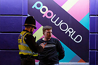 Pictured: A young man is detained by a police officer in Swansea. Tuesday 31 December 2019 to Wednesday 01 January 2020<br /> Re: Revellers on a night out for New Year's Eve in Wind Street, Swansea, Wales, UK.