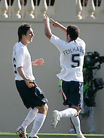 Sacha Kljestan celebrates with Benny Feilhaber on Feilhaber's goal. The USA defeated China, 4-1, in an international friendly at Spartan Stadium, San Jose, CA on June 2, 2007.