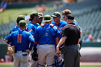 Iowa Cubs pitching coach Rod Nichols (50) meets with his players on the mound during a game against the Memphis Redbirds on May 29, 2017 at AutoZone Park in Memphis, Tennessee.  Memphis defeated Iowa 6-5.  (Mike Janes/Four Seam Images)