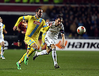 Swansea, UK. Thursday 20 February 2014<br /> Pictured L-R: Gonzalo Higuain of Napoli on the attack against Chico Flores of Swansea.<br /> Re: UEFA Europa League, Swansea City FC v SSC Napoli at the Liberty Stadium, south Wales, UK