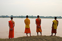Buddhist Monks overlooking the Mekong River towards Thailand in Vientiane