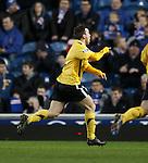 David Gray runs to the Montrose fans as he celebrates his goal