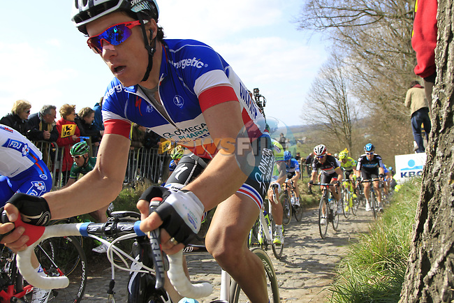 The peloton including French Champion Sylvain Chavanel (FRA) Omega Pharma-Quickstep climbs Koppenberg during the 96th edition of The Tour of Flanders 2012, running 256.9km from Bruges to Oudenaarde, Belgium. 1st April 2012. <br /> (Photo by Eoin Clarke/NEWSFILE).