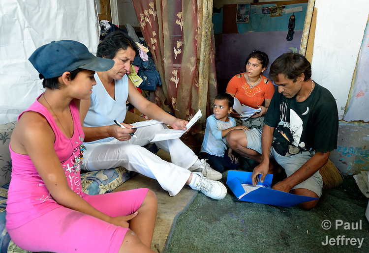 Ljatife Sikovska (second from left) is director of Ambrela, a grassroots Roma women's organization in Suto Orizari, the Macedonian municipality that is Europe's largest Roma settlement. Here she talks with a family in their home in Suto Orizari about their lack of sufficient legal documents, a common headache for Roma in Macedonia.