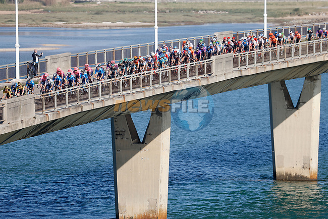 The peloton during Stage 10 of the Vuelta Espana 2020 running 187.4km from Castro Urdiales to Suances, Spain. 30th October 2020.    <br /> Picture: Luis Angel Gomez/PhotoSportGomez | Cyclefile<br /> <br /> All photos usage must carry mandatory copyright credit (© Cyclefile | Luis Angel Gomez/PhotoSportGomez)