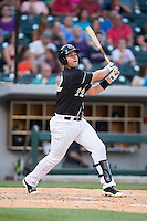 Matt Davidson (22) of the Charlotte Knights follows through on his swing against the Columbus Clippers at BB&T BallPark on May 27, 2015 in Charlotte, North Carolina.  The Clippers defeated the Knights 9-3.  (Brian Westerholt/Four Seam Images)