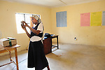 A high school girl photographs  the Hatua Likoni .Foundation's office during a photo workshop in Likoni, Kenya.   The workshop was organized by the Foundation's founder, Gabrielle Fondiller, and  New York photographer Todd Shapera, using cameras from U.S. donors.   This female student receives a financial scholarship from the Hatua Likoni Foundation to enable her attend a quality, private high school in Likoni - Moi Forces.  The photography workshop took place on two Sunday afternoons in February for 32 students, and is part of a Sunday mentoring program offered by Hatua Likoni to the Foundation's scholarship students..