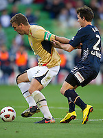 MELBOURNE, AUSTRALIA - DECEMBER 27: Robbie Kruse of the Victory and Ljubo Milicevic of the Jets contest the ball during the round 20 A-League match between the Melbourne Victory and the Newcastle Jets at AAMI Park on December 27, 2010 in Melbourne, Australia. (Photo by Sydney Low / Asterisk Images)