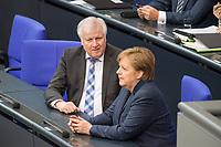 Sitzung des Deutschen Bundestag am Mittwoch den 4. Maerz 2020.<br /> Im Bild: Bundesinnenminster Horst Seehofer, CSU (links) im Gespraech mit Bundeskanzlerin Angela Merkel (CDU).<br /> 4.3.2020, Berlin<br /> Copyright: Christian-Ditsch.de<br /> [NUR FUER REDAKTIONELLE ZWECKE! Werbung nur auf Anfrage beim Fotografen. Inhaltsveraendernde Manipulation des Fotos nur nach ausdruecklicher Genehmigung des Fotografen. Vereinbarungen ueber Abtretung von Persoenlichkeitsrechten/Model Release der abgebildeten Person/Personen liegen nicht vor. NO MODEL RELEASE! Don't publish without copyright Christian-Ditsch.de, Veroeffentlichung nur mit Fotografennennung, sowie gegen Honorar, MwSt. und Beleg. Konto: I N G - D i B a, IBAN DE58500105175400192269, BIC INGDDEFFXXX, Kontakt: post@christian-ditsch.de<br /> Bei der Bearbeitung der Dateiinformationen darf die Urheberkennzeichnung in den EXIF- und  IPTC-Daten nicht entfernt werden, diese sind in digitalen Medien nach §95c UrhG rechtlich geschuetzt. Der Urhebervermerk wird gemaess §13 UrhG verlangt.]