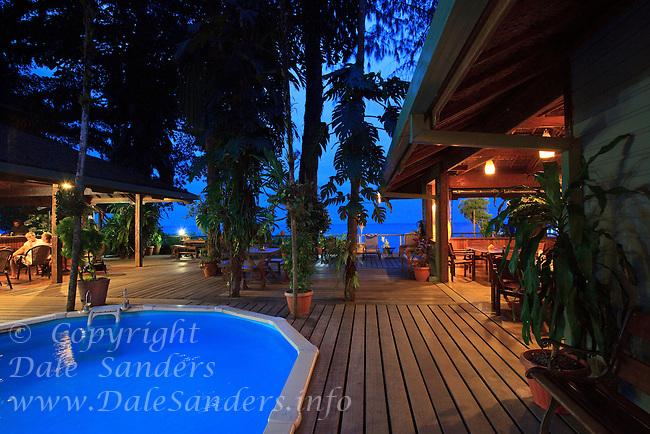 Walindi Resort pool, bar  and dining area at dusk, New Britain Island, Papua New Guinea.