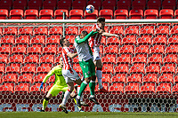 5th April 2021; Bet365 Stadium, Stoke, Staffordshire, England; English Football League Championship Football, Stoke City versus Millwall; Harry Souttar of Stoke City heads the ball clear in his goal area