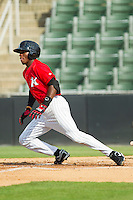 Tim Anderson (2) of the Kannapolis Intimidators starts down the first base line against the Greenville Drive at CMC-Northeast Stadium on June 29, 2013 in Kannapolis, North Carolina.  The Intimidators defeated the Drive 9-3 in the completion of the game that began on June 28, 2013.   (Brian Westerholt/Four Seam Images)