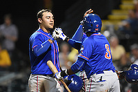 St. Lucie Mets outfielder Michael Conforto (21) is congratulated by Maikis De La Cruz (3) after hitting a home run during a game against the Bradenton Marauders on April 11, 2015 at McKechnie Field in Bradenton, Florida.  St. Lucie defeated Bradenton 3-2.  (Mike Janes/Four Seam Images)