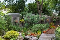 Cisterns disguised behind trellis in backyard garden; Judy Adler Garden, Walnut Creek, California
