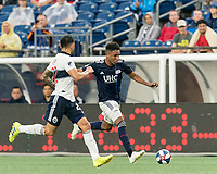 FOXBOROUGH, MA - JULY 17: Juan Agudelo #17 dribbles down the wing during a game between Vancouver Whitecaps and New England Revolution at Gillette Stadium on July 17, 2019 in Foxborough, Massachusetts.