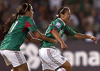 Veronica Perez of Mexico (R) celebrates during the semifinal match of CONCACAF Women's World Cup Qualifying tournament held at Estadio Quintana Roo in Cancun, Mexico. Mexico 2, USA 1.